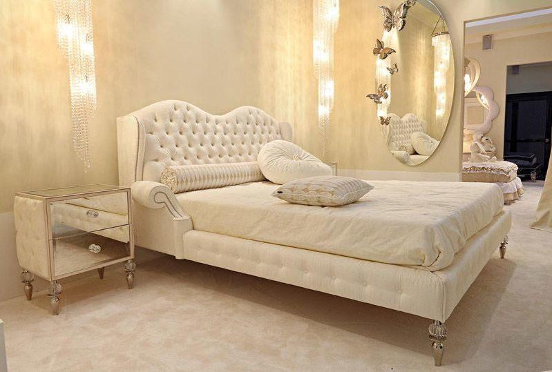 Кровать с мягким изголовьем в интерьере 11